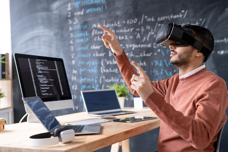 Young programmer in vr headset testing or presenting new software