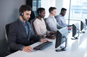 Attentive customer service executives working at office