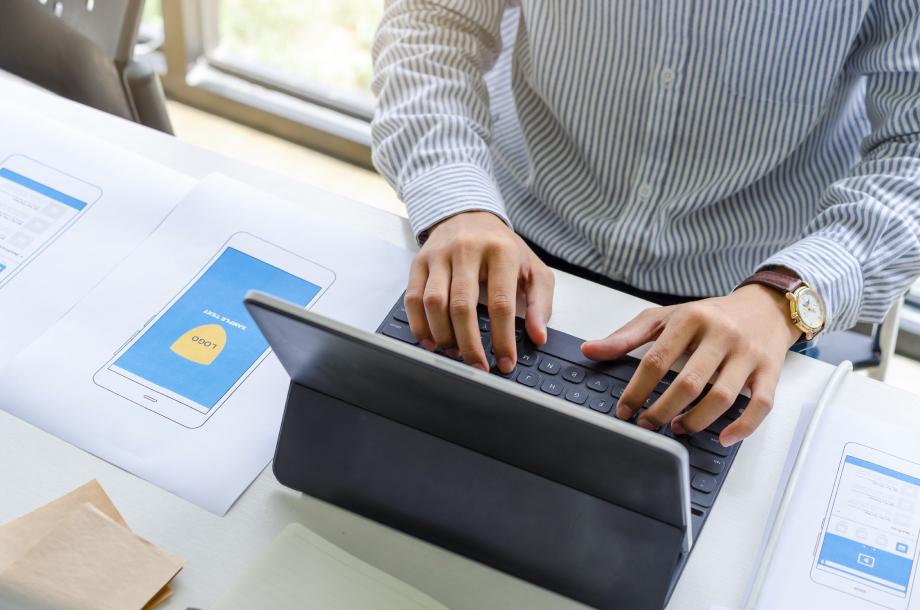A man operates a computer